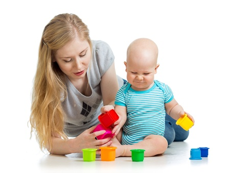 baby boy and mother playing together with colorful toys Stock Photo - 17499560