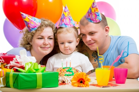 kid girl with parents on birthday party Stock Photo - 17499551