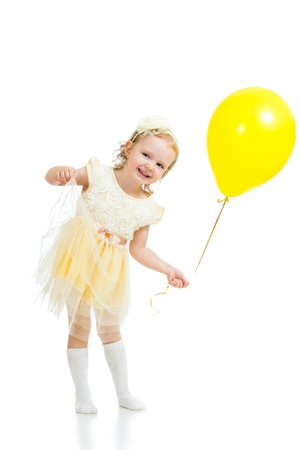 happy kid girl with yellow balloon on white background Stock Photo - 17499562