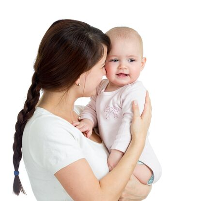 Happy mother holding her baby girl isolated Stock Photo - 17537925