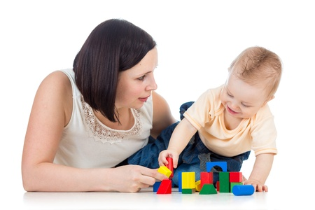 baby boy and mother playing together with construction set toy Stock Photo - 17537900