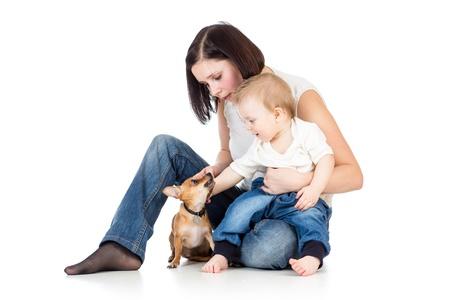 boy lady: mother, baby boy and dog isolated on white background Stock Photo
