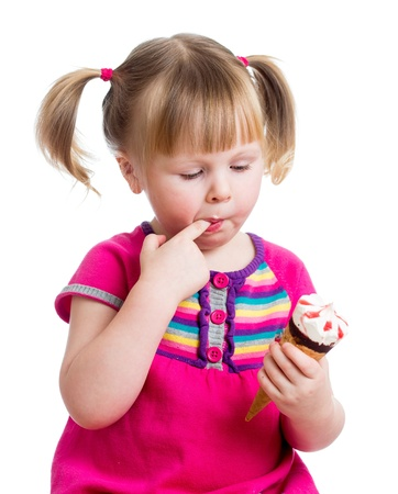 happy kid girl eating ice cream in studio isolated Stock Photo - 17605117