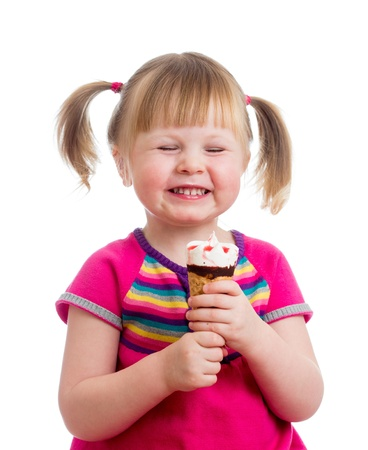 happy kid girl eating ice cream in studio isolated Stock Photo - 17605114