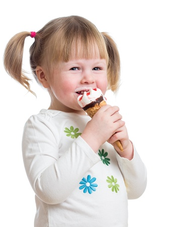 cute little girl eating ice cream in studio isolated Stock Photo - 17605111