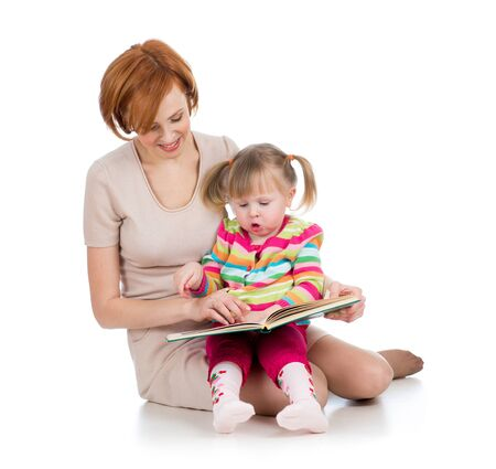 happy mother and kid girl reading a book together Stock Photo - 17605106