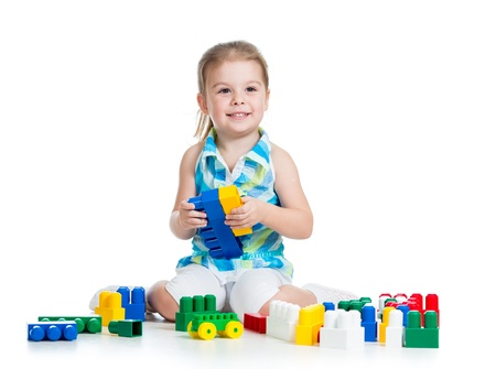 kid girl with construction set toy over white background Stock Photo - 17605100