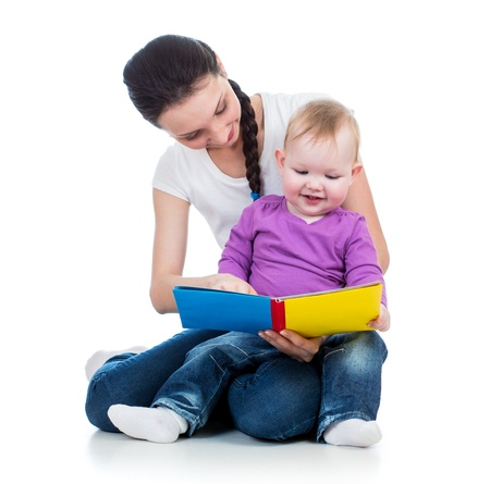 happy mother reading a book to her daughter Stock Photo - 17641818
