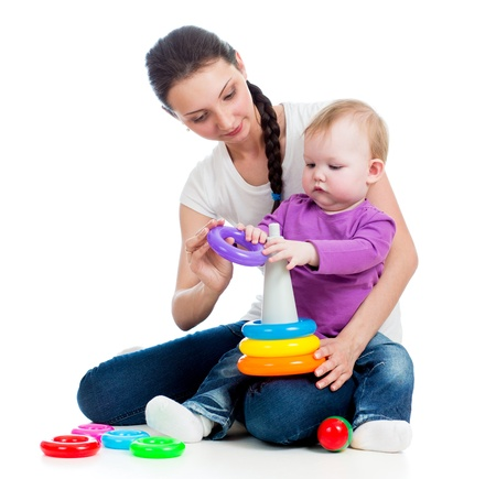 baby girl and mother playing together with toy Stock Photo - 17641817