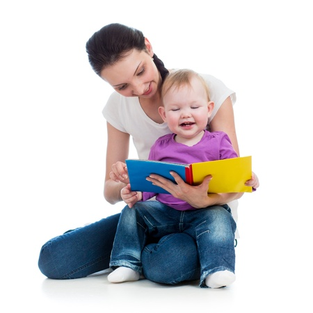 happy mother reading a book to baby girl Stock Photo - 17687364