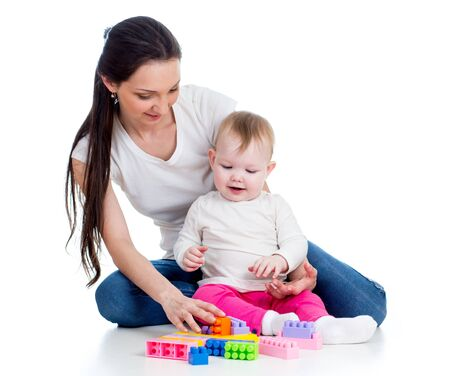 baby girl and mother playing together with toy photo