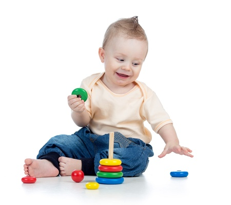 happy baby boy playing with colorful toy isolated on white photo