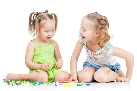 children playing together: children sisters paly together, isolated on white background