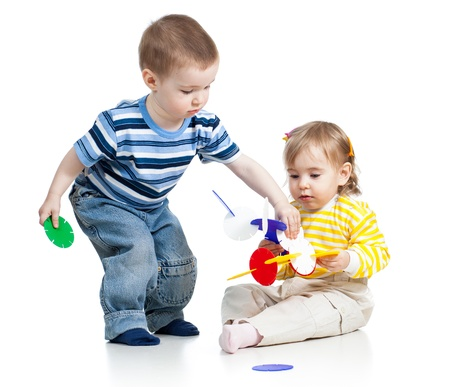 children boy and girl play with educational toy over white background photo