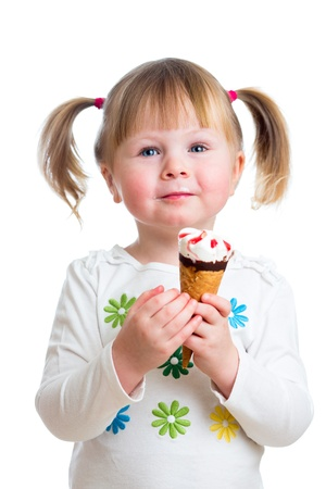 cute kid girl eating ice cream in studio isolated Stock Photo - 17797881