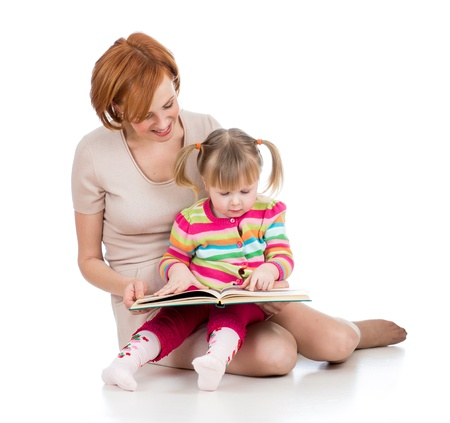 happy mother and child girl reading a book together Stock Photo - 17797875