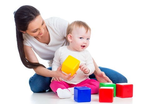 mother and baby playing with building blocks toy isolated on white Stock Photo - 17797858