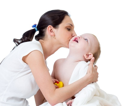 mother kissing baby after bathing photo