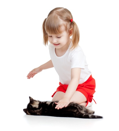 happy child girl playing with cat kitten photo