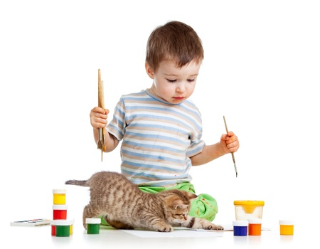 kid drawing paints with cat kitten photo