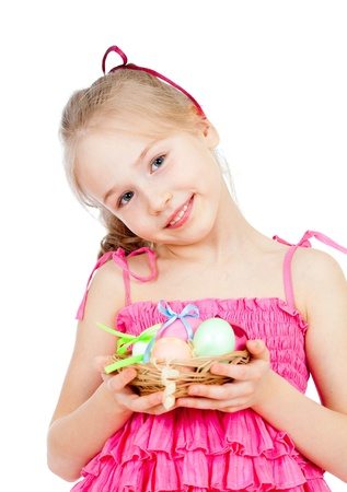 cute smiling little girl holding Easter eggs in basket Stock Photo - 17797884