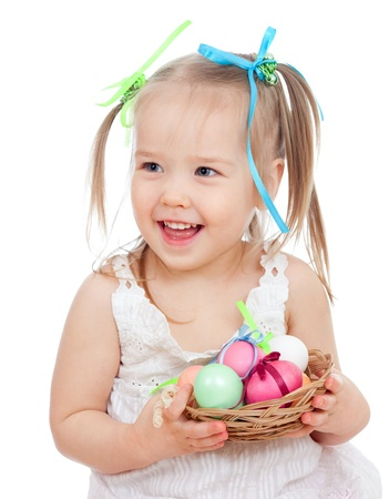 cute smiling baby girl holding Easter eggs in basket isolated on white background Stock Photo - 17797880