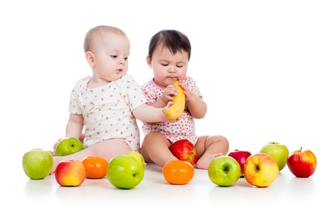 funny fruit: Funny children babies with healthy food fruits isolated on white background Stock Photo
