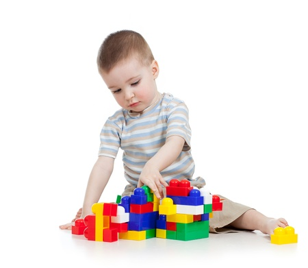 assiduous: baby boy playing with block toy over white background Stock Photo
