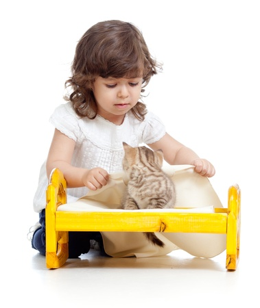 curly child girl playing with kittens photo