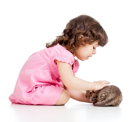 pink pussy: little kid girl playing with cat kitten