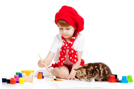 child painting and playing with cat kitten photo