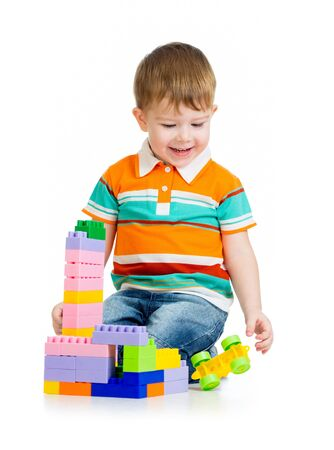kid boy playing with toys isolated on white background Stock Photo - 17926482