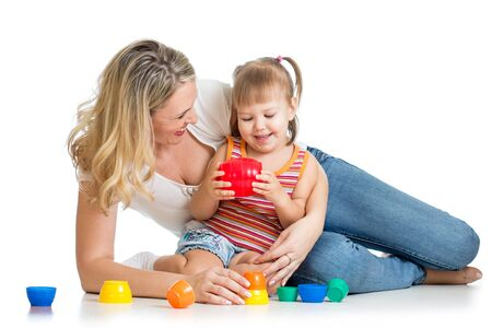 kid girl and mother playing together with colorful toys Stock Photo - 17926484