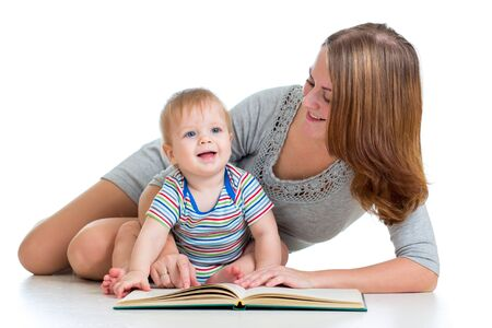 interested baby: mother reading a book to her baby boy