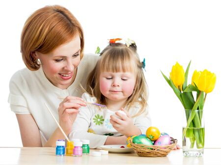 mother and baby kid painting easter eggs isolated photo