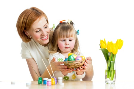 creative egg painting: mother and baby kid painting easter eggs