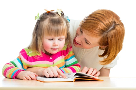 child reading: happy mother and child reading a book together