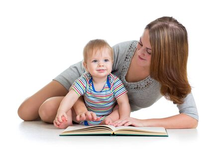 cute mother reading a book to her kid boy photo
