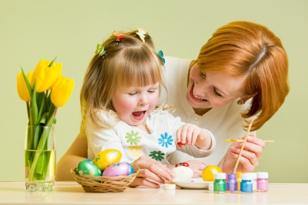 mother and kid girl play and prepare to easter photo