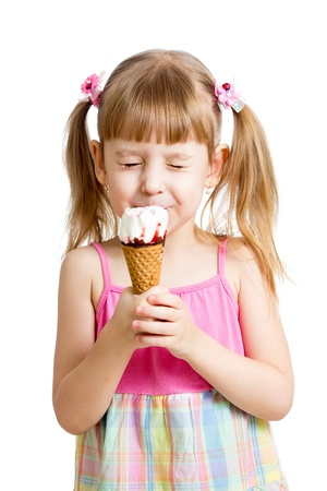 kid girl eating ice cream in studio isolated photo