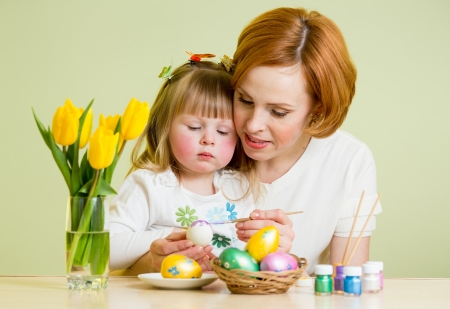 mother and child kid paint easter eggs photo