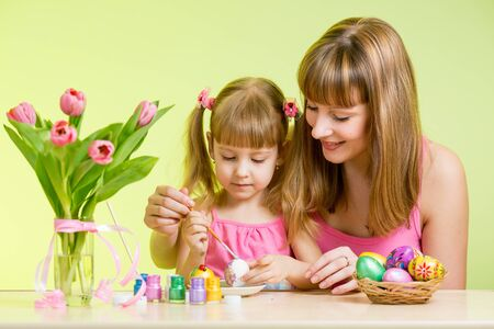 mother and daughter kid painting easter eggs Stock Photo - 18062254