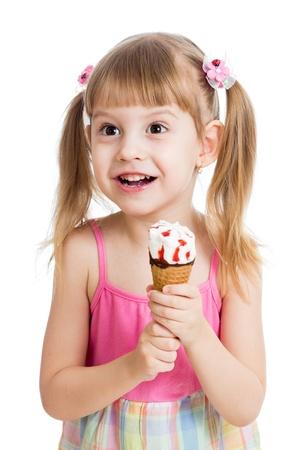 happy child girl eating ice cream in studio isolated Stock Photo - 18062274