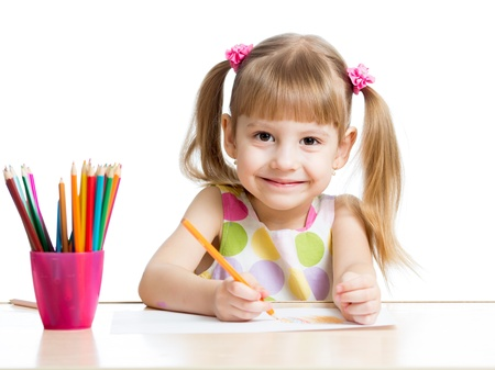 children painting: cute girl drawing with colourful pencils Stock Photo