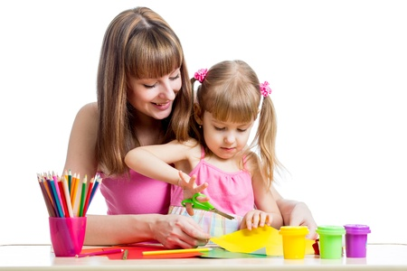 Mother teaches preschooler kid to do craft items  DIY concept  photo