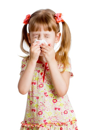 cold cure: child girl wiping or cleaning nose with tissue isolated on white