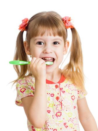 cute kid girl brushing teeth isolated on white background photo