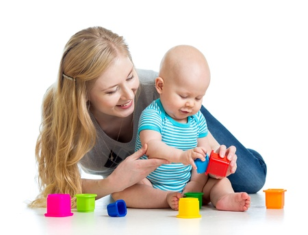 children playing with toys: kid boy and mother playing together with cup toys Stock Photo