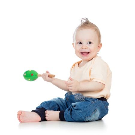Baby  boy with musical toys  Isolated on white background photo