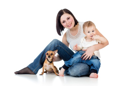 keen: mother, baby boy and dog isolated on white Stock Photo
